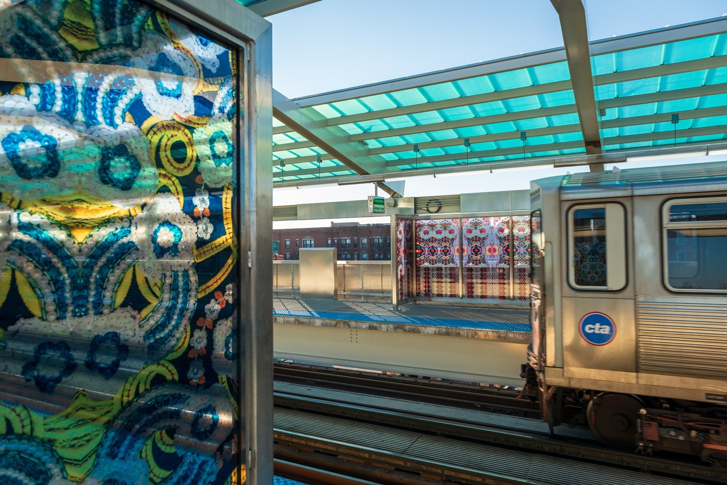 New artistically enhanced windbreaks at Garfield Green Line by Chicago artist Nick Cave