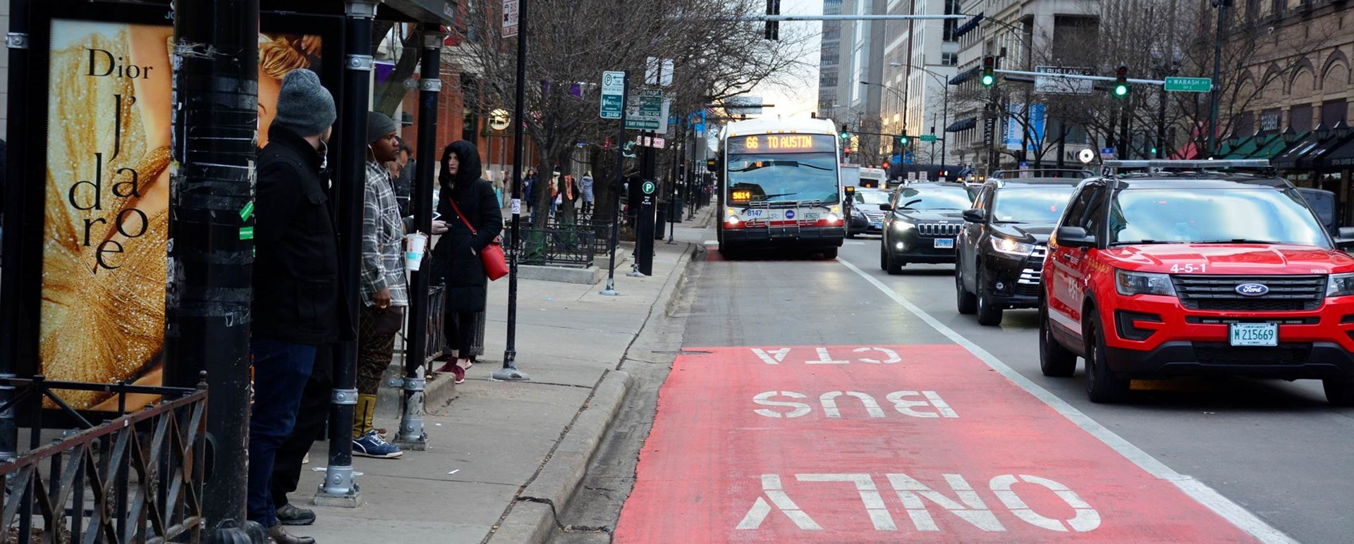 A #66 Chicago bus traveling in a bus only lane.