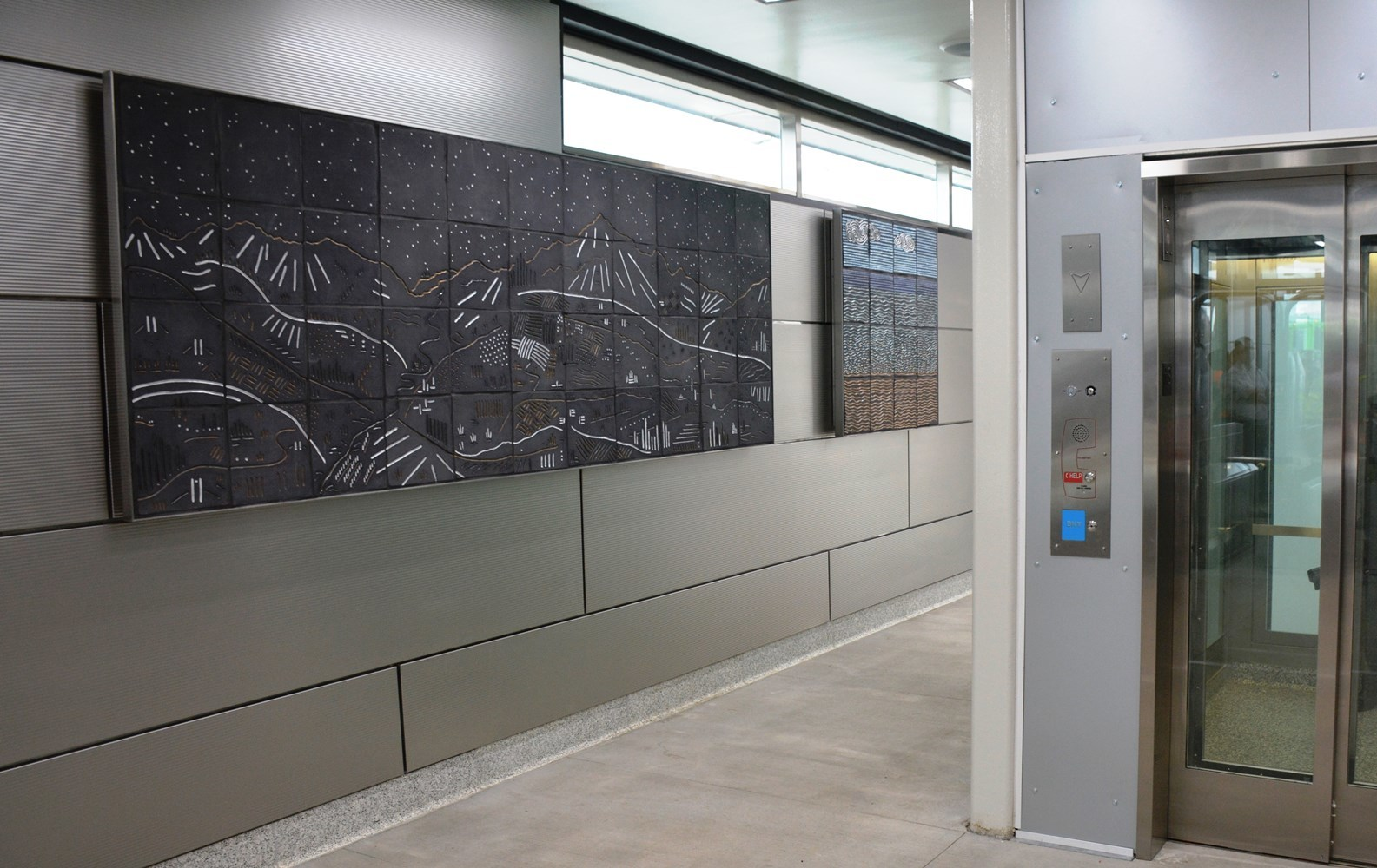 Riders passing through the Ogden entrance of IMD are welcome by two ceramic tile murals known as Vista and Beach, respectively.