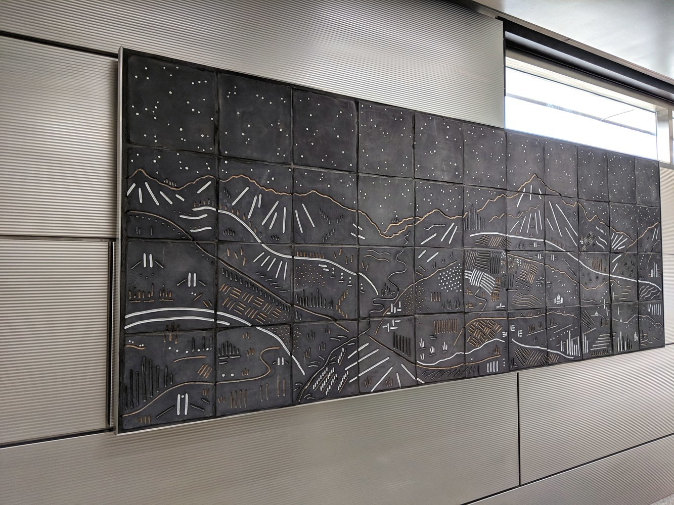 "IMD station features a new series of artwork known as ""Vacation"" by Chicago artists Jason Messinger. Shown is the ""Vista"" mural in the Ogden Avenue entrance."