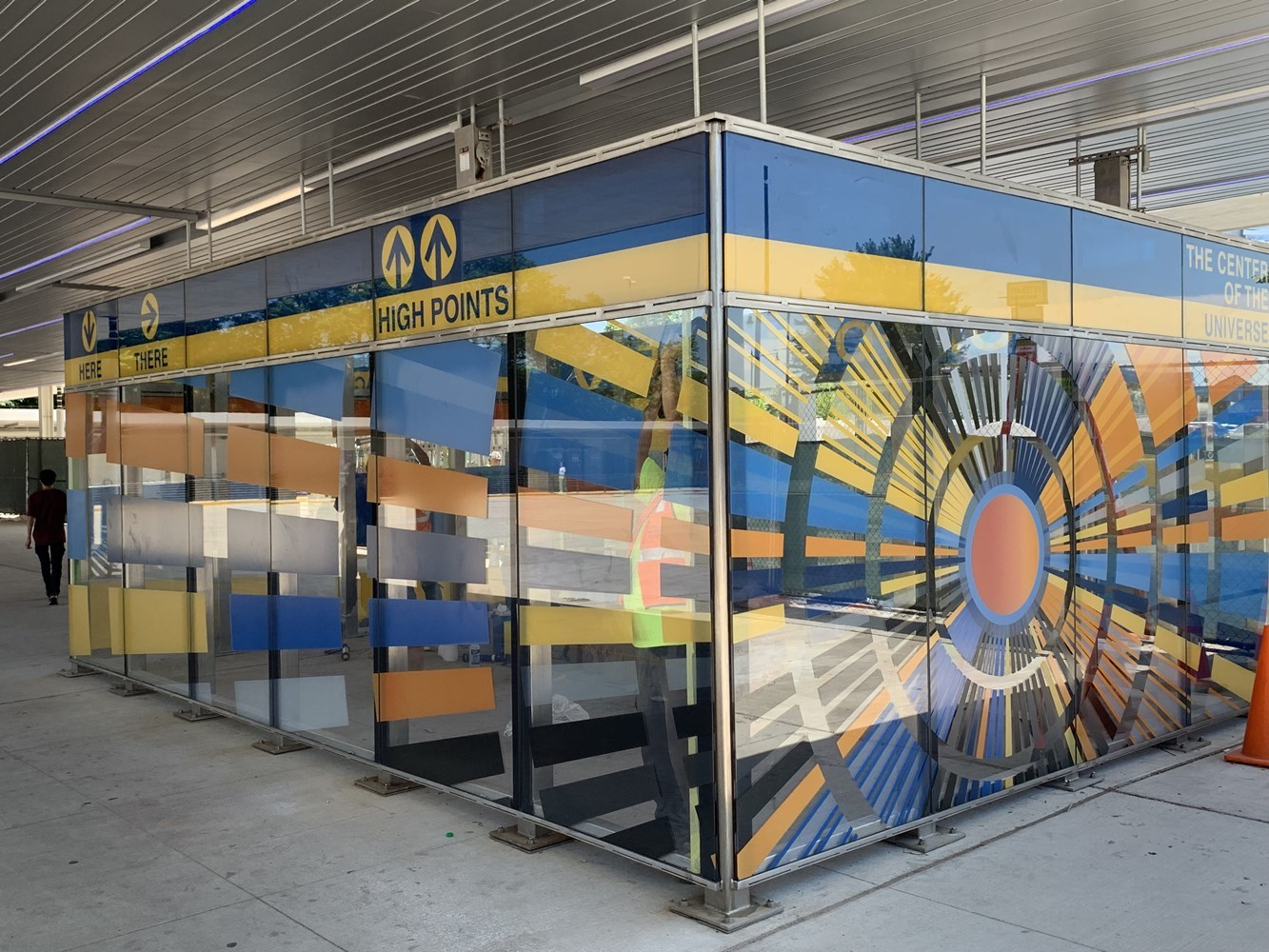 Bus waiting area at Jefferson Park featuring new art glass installation