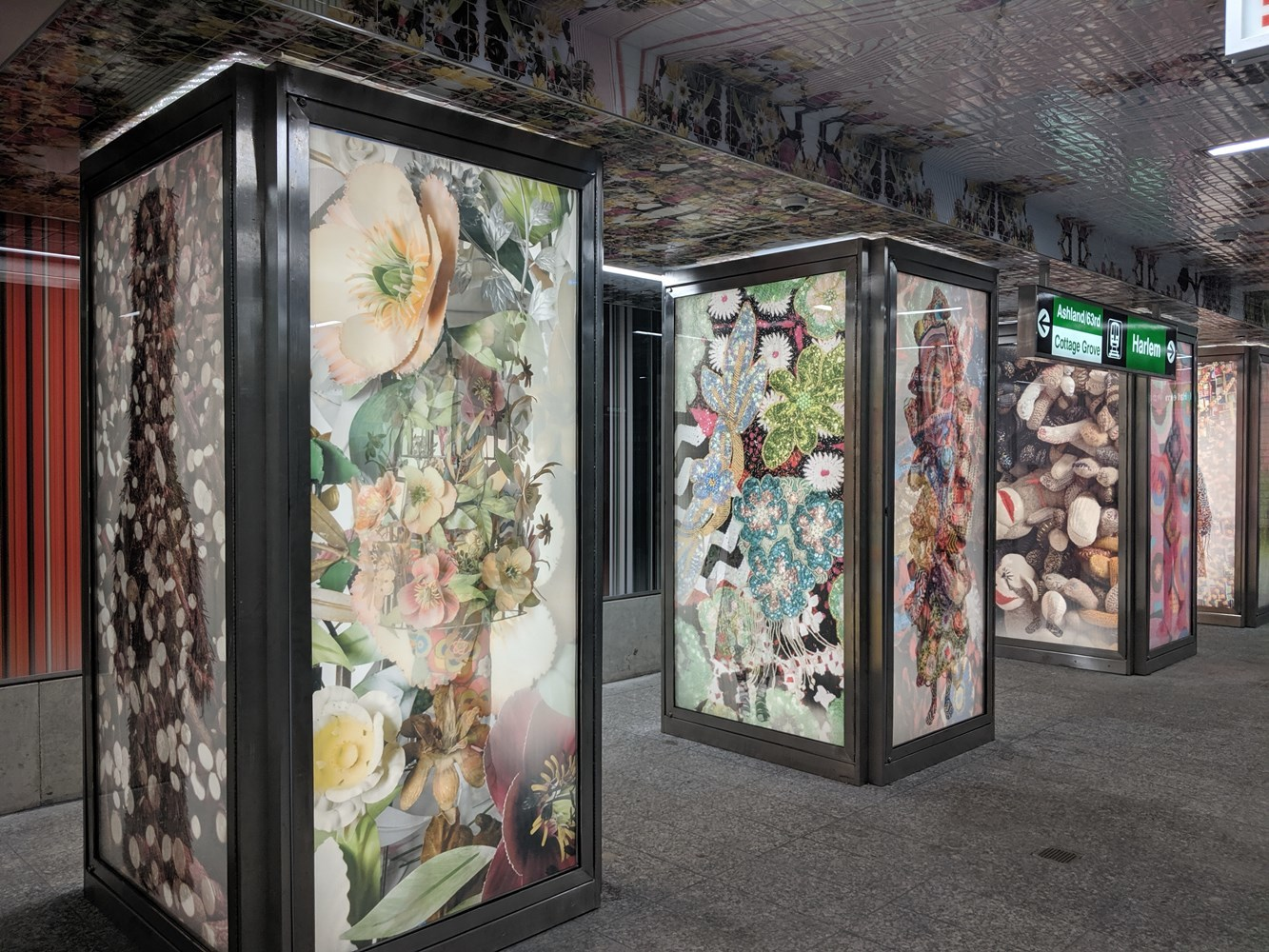 "Station interior: Backlit, lenticular columns featuring the artist's multi-disciplinary artwork also known as ""Sound Suits"""