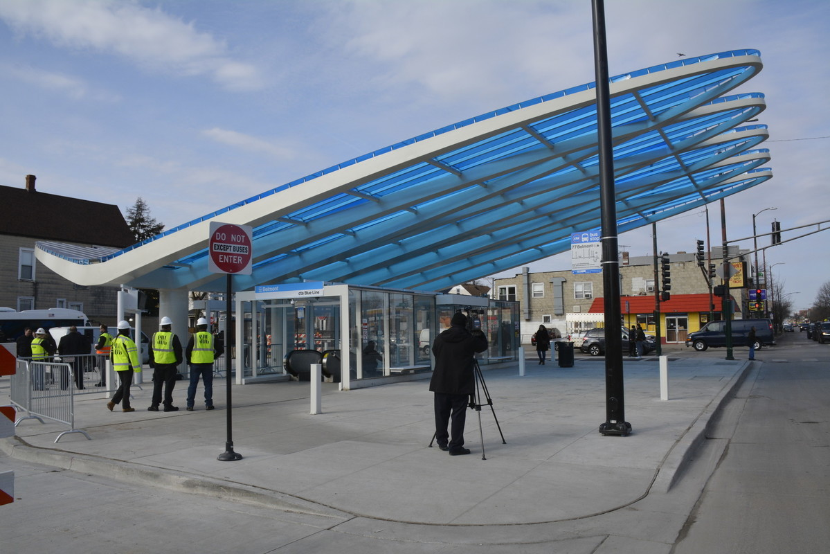 Image of new completed architectural canopy constructed for the Belmont Blue Line station entrance and bus boarding area.