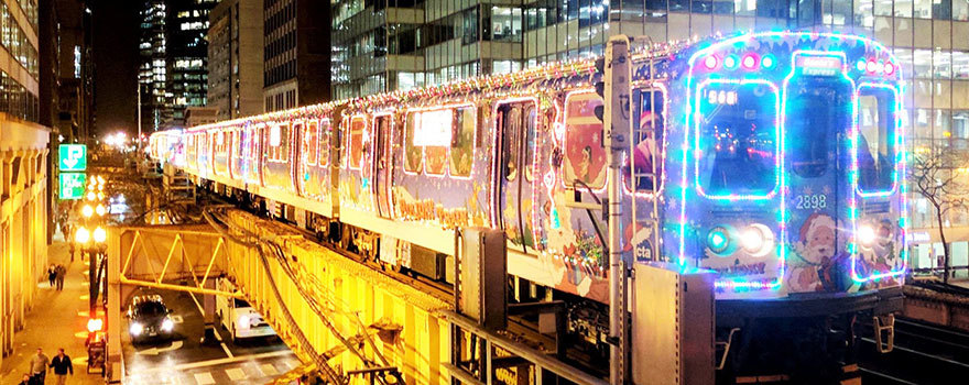 The Holiday Train aglow on the Loop Elevated