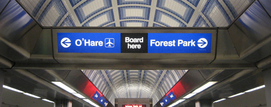 Sign showing trains to either O'Hare or Forest Park on each platform side